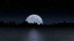 Full Rising Moon Reflecting off Lake with Trees on Horizon - stock footage