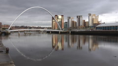 Baltic Art Centre and Millennium Bridge, Gateshead reflected in river Tyne Stock Footage