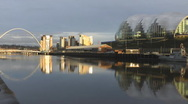 Stock Video Footage of River Tyne in low evening sunlight, Millenium Bridge, Sage & Baltic Arts