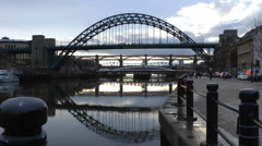 Tyne Bridges at rush hour from the Quayside, early evening in winter Stock Footage