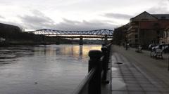 Railway bridge over River Tyne in low evening sun Stock Footage
