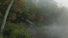 Lake boathouse foggy morning Stock Footage