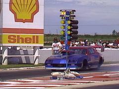 Motorsports, drag racing, purple camaro launch out of frame 2000hp doorslammer Stock Footage