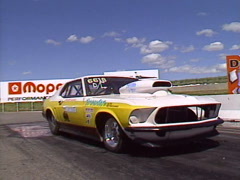 Motorsports, drag racing, Super-Gas mustang burnout, in the waterbox Stock Footage