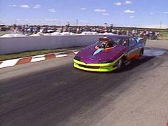 Motorsports, Drag Racing, 2000hp Pro Mod Camaro doing a smoky burnout Stock Footage