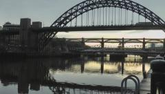 Pan up to Tyne Bridge from mooring ring on quayside Stock Footage