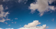 Stock Video Footage of 2K video 30p v2 - Winter clouds puff in a crisp deep blue sky in timelapse