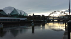 Tyne Bridge and Gateshead Sage Centre in low sunlight Stock Footage