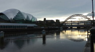 Stock Video Footage of Tyne Bridge and Gateshead Sage Centre in low sunlight