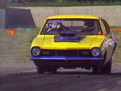Motorsports, drag racing, SuperPro ford Maverick burnout long lens Stock Footage