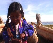 Lake Titicaca, Uros indian girl Stock Footage