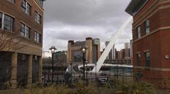 View between two office blocks across ornamental steps to Millennium Bridge Stock Footage