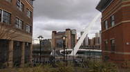 Stock Video Footage of View between two office blocks across ornamental steps to Millennium Bridge