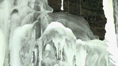 Icicles hanging from eroded limestone coastline on the island of Gotland Stock Footage
