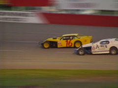 Motorsports, IMCA stock car race 2 cars tight. Evening race Stock Footage