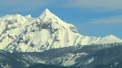 Snow Capped mountain Peaks against sky Panoramic Stock Footage