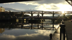 Tyne bridges reflected in still water with low evening sun Stock Footage