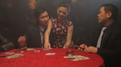 Female turning over winning card in black jack game Stock Footage