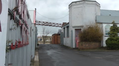 Walk into scruffy old small light industrial estate, Stock Footage