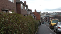 Urban street with old 1950's shipyard workers houses,and modern buildings Stock Footage