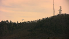 Two helos over the mountain Stock Footage