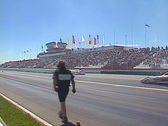 Motorsports, drag racing, Top Fuel funny car in reverse, wide through frame Stock Footage