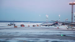 Area for aircraft at airport, machine cleans snow - stock footage