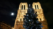Stock Video Footage of Notre Dame Cathedral, in front of christmas tree