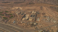 Stock Video Footage of Aerial view of major construction and grading of the desert