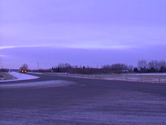 Trucking, transport truck and concrete bunker load, early dawn winter Stock Footage