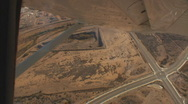 Stock Video Footage of Aerial view of an intersection of roads in the desert while making a sharp turn