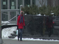 Walking Woman Bundled Up For Winter Stock Footage