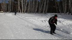 Skiers go down the hill Stock Footage