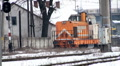 A freight train passes through an urban area Footage