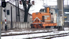 A freight train passes through an urban area Stock Footage