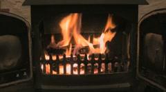 Roaring log fire in woodburner Stock Footage