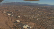 Looking down at a flood wash after takeoff with zoom in on freeway Stock Footage