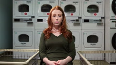 Laundry flung around women Stock Footage