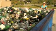 Woman puts Glass Bottles into Recycling Container GFHD Stock Footage