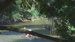 Thailand: Bamboo rafts from river bank Stock Footage