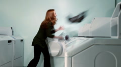 Laundry flung at women Stock Footage