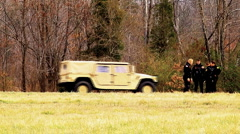Army national guard humvee and helicopter Stock Footage