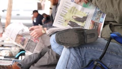 Men reading newspapers - stock footage