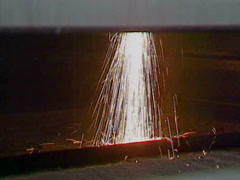 Industrial sparks from metal cutting machine, nice splashing, wide Stock Footage