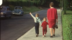 Family walk in the 1960s (vintage 8 mm amateur film) - stock footage