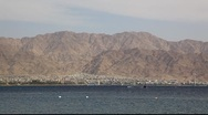 Stock Video Footage of Skyline of Aqaba, Jordan: coastline, beach, mountains and bay