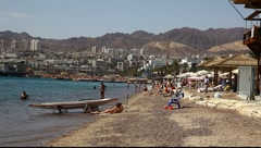 Skyline of Eilat: coastline, beach, hotels, promenade, mountains and bay Stock Footage