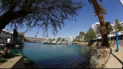 The lagoon in Eilat: yachts, calm blue water, promenade Stock Footage