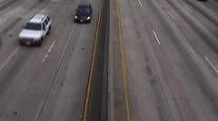 LA freeway pan up and zoom with traffic in motion Stock Footage