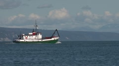 Green boat under way on gorgeous bay waters Stock Footage